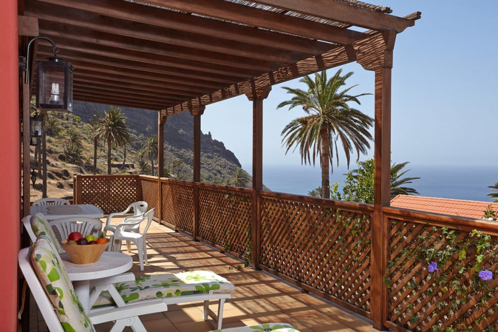 terrace with view of sea and palms